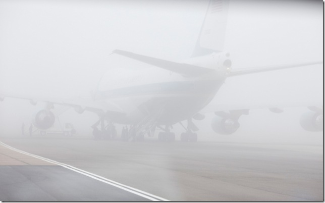 Air Force One is shrouded in fog April 3, 2009, on the tarmac at Stansted Airport in England. Official White House Photo by Pete Souza